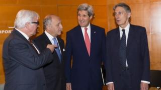 John Kerry (2nd right) speaks to the foreign ministers of Germany, France and the UK in Paris (15 December 2014)
