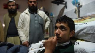 Wounded Pakistani student Ans in hospital in Peshawar. 16 Dec 2014