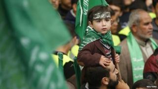 A Palestinian boy at a Hamas rally in the Gaza Strip (12 December 2014)