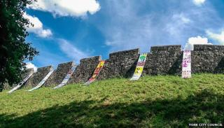 Banners hung on York city walls