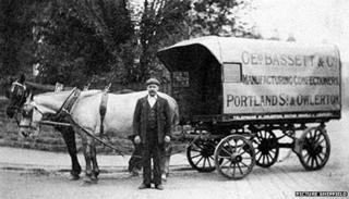 The inventor of Liquorice Allsorts, George Bassett, is shown with his horse-drawn delivery van in 1910