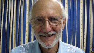 American Alan Gross poses for a photo during a visit by Rabbi Elie Abadie and U.S. lawyer James L. Berenthal at Finlay military hospital as he serves a prison sentence in Havana, Cuba 27 November 2012