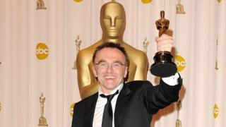 Danny Boyle poses with the Best Director Oscar for Slumdog Millionaire in 2009