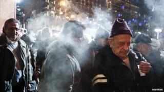 Pensioners receive free food as part of a night-long anti-austerity protest in Athens (10 December 2014)