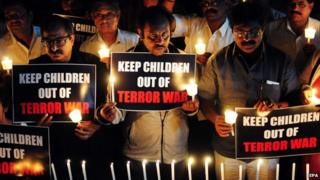 Indian journalists and NGO workers hold a candlelight vigil for the victims of the Taliban attack on a Pakistani school, Bangalore, India, 17 December 2014.