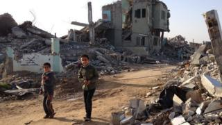 Children play among the rubble of war-torn Gaza