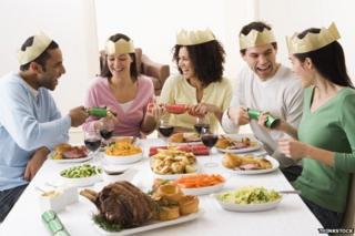 Five people enjoying beef for Christmas dinner