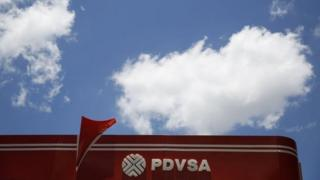 The PDVSA logo is seen at its gas station in Caracas in this 29 August, 2014 file photo