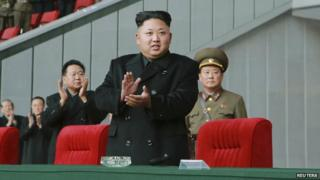 """North Korean leader Kim Jong Un attends a women""""s soccer match between the national team and the Wolmido team at the remodelled May Day Stadium in Pyongyang on October 28, 2014"""