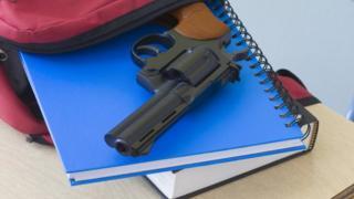 Gun in backpack