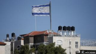 Israeli flag flies over settlement building in the middle of Palestinian neighbourhood of al-Tur in East Jerusalem. 11 November 2014
