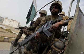Pakistan army soldiers outside the army public school attacked by the Taliban in Peshawar 18 December 2014