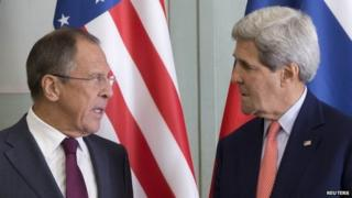 U.S. Secretary of State John Kerry chats with Russian Foreign Minister Sergey Lavrov (L) as they meet at the Chief of Mission Residence in Paris October 14, 2014