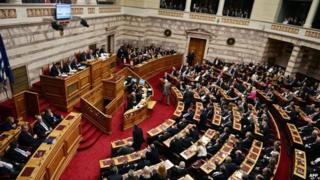 Lawmakers vote at the Greek Parliament in Athens during the first round of a three-stage presidential election in Greece on December 17, 2014