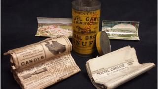 The snuff tin time capsule and its contents from 1909
