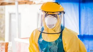 A healthcare worker in protective gear is seen at an Ebola treatment centre in the west of Freetown, Sierra Leone, in October 2014