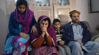 Andaleeb Aftab, a teacher at the school, mourns her child with her husband, son and daughter