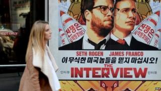 Poster for the film The Interview outside of Regal Theatre in New York, 18 Dec