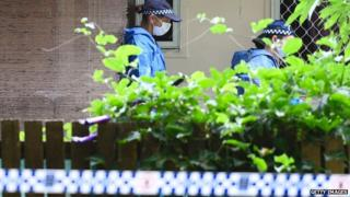 Forensic teams at the Cairns home where eight children were killed (December 2014)