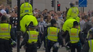 Police surround Newcastle United fans