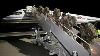 Reservists board flight