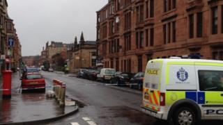 Police van at scene in Ardbeg Street