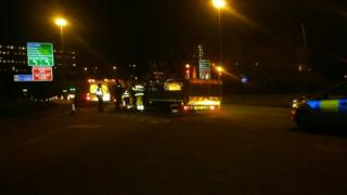 Emergency workers at the scene of the double shooting on Derek Dooley Way, Sheffield