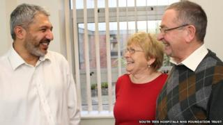 ENT consultant Anirvan Banerjee (left), shares a joke with patient Bridie Hope and her husband Ian.