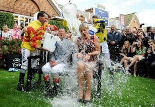 Frankie Dettori and Clare Balding take the ice bucket challenge