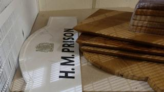 Chopping boards and HM Prison sign