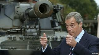 Nigel Farage stands in front of a Chieftain mk 10 battle tank, at the Heywood Tank Museum in Lancashire while campaigning there in October
