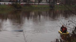 A minibus has gone into the River Lagan
