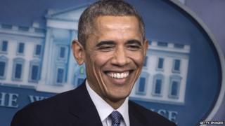 President Barack Obama smiles.
