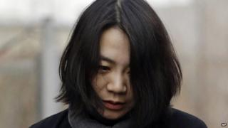 In this Dec. 12, 2014 file photo, Cho Hyun-ah, who was head of cabin service at Korean Air and the oldest child of Korean Air Chairman Cho Yang-ho, speaks to the media upon her arrival for questioning at the Aviation and Railway Accident Investigation Board office of Ministry of Land, Infrastructure and Transport in Seoul, South Korea