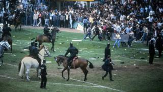 Football fans invade pitch at Birmingham v Leeds match on 11 May 1985