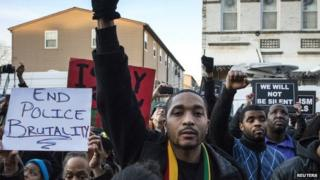 Protesters, demanding justice for Akai Gurley, march towards New York Police Department's (NYPD) 75th Precinct from the site of his shooting death in Brooklyn, New York 27 December 2014