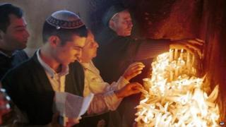 Jewish pilgrims light candles at a shrine dedicated to Rabbi Yaakov Abuhatzeira in Damanhur, Egypt (1999)
