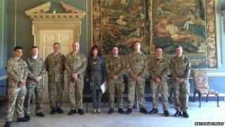 June Davey with soldiers at Clandon Park