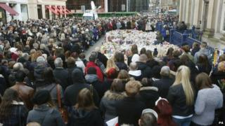 Mourners gather at Royal Exchange Square following the bin lorry crash