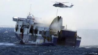 In this image released by the Italian Navy, smoke billows from the Italian-flagged Norman Atlantic that caught fire in the Adriatic Sea, Monday, Dec. 29, 2014