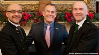 Joe Schofield (left) and partner Malcolm Brown (right) pose for a photograph ahead of their marriage, along with Ross Wright from the Humanist Society Scotland.