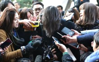 Cho Hyun-Ah (centre) is surrounded by journalists outside a court in Seoul on 30 December 2014