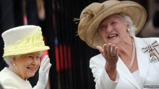 The Queen was greeted by Dame Mary Peters during her most recent visit to Belfast in June 2014