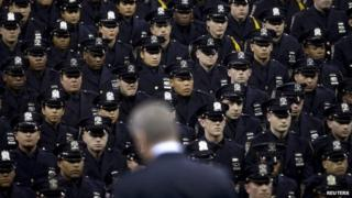 New York Mayor Bill de Blasio speaks from the podium to the New York City Police Academy Graduating class in New York December 29, 2014