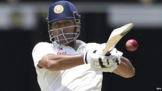Indian batsman MS Dhoni plays a shot on day two of the second Test match between Australia and India at the Gabba in Brisbane, Australia, 18 December 2014