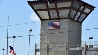 """US military shows the razor wire-topped fence and the watch tower of """"Camp 6"""" detention facility at the US Naval Station in Guantanamo Bay, Cuba, on 8 April 2014"""