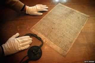 A facsimile copy of the 1215 document, the Magna Carta in the Library at Salisbury Cathedral