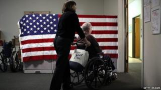 US flag and pensioner in wheelchair
