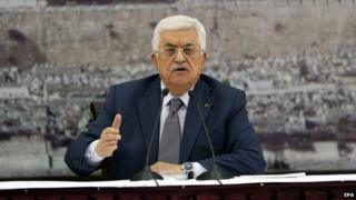 Palestinian President Mahmoud Abbas during a meeting to sign more than 20 international treaties, including the Rome Statute of the International Criminal Court, in the West Bank city of Ramallah, 31 December 2014