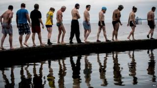 Swimmers prepare to enter the water at Clevedon Marina